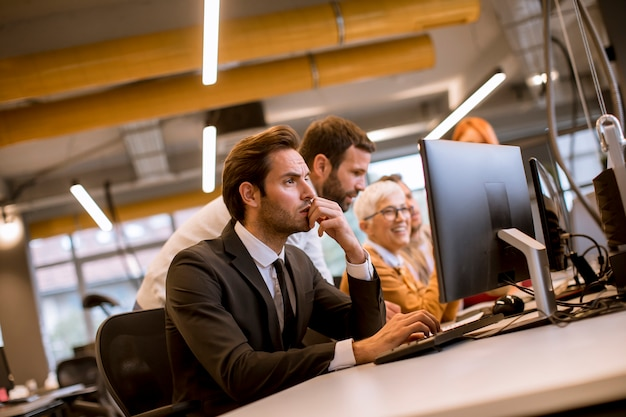 Young professional businessman uses a laptop for work in the office
