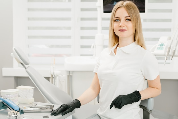 Young professional woman dentist in the office