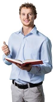 ペンと本を持って教えている若い教授