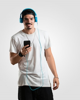 Young rapper man happy and fun, listening to music
