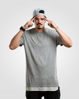 Young rapper man man making a concentration gesture, looking straight ahead focused on a goal