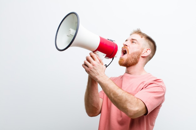 Young red head man with a megaphone