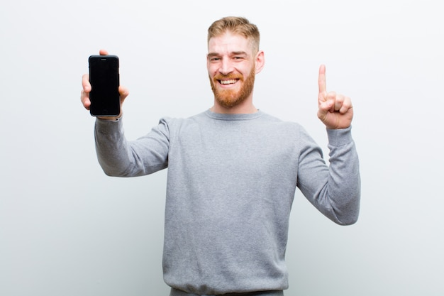 Young red head man with a smart phone