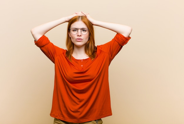 Young red head pretty woman feeling frustrated and annoyed, sick and tired of failure, fed-up with dull, boring tasks