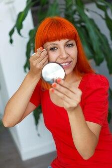 Young redhead girl using tweezers