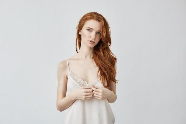 Young redhead woman posing.