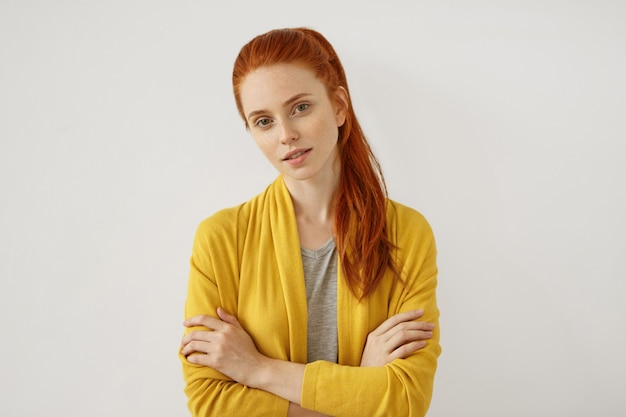 Young redhead woman posing