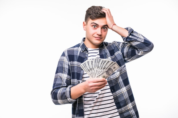 Young rich man in casual t-shirt holding fan of dollar bills