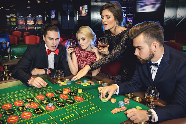 Young and rich people playing roulette in the casino