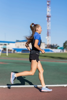 Young runner woman at stadium