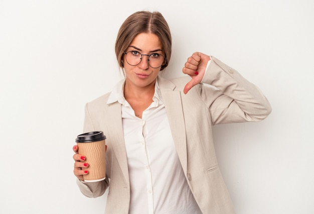 Young russian business woman holding banknotes isolated on white background showing a dislike gesture, thumbs down. disagreement concept.