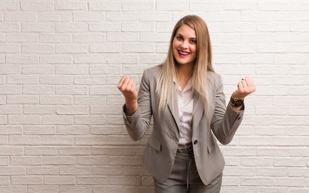 Young russian business woman surprised and shocked