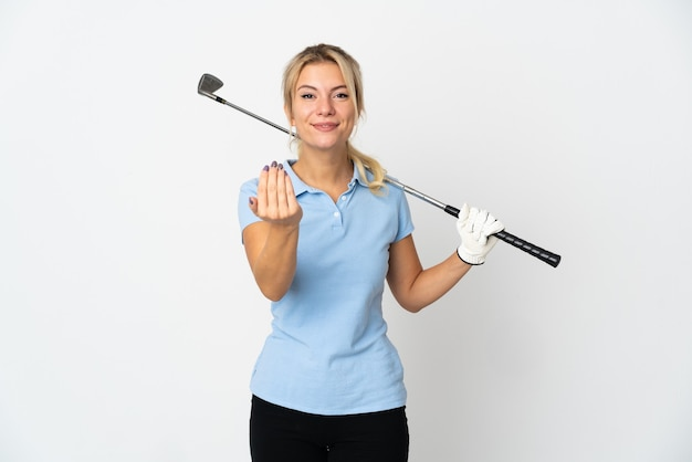 Young russian golfer woman isolated on white background inviting to come with hand. happy that you came
