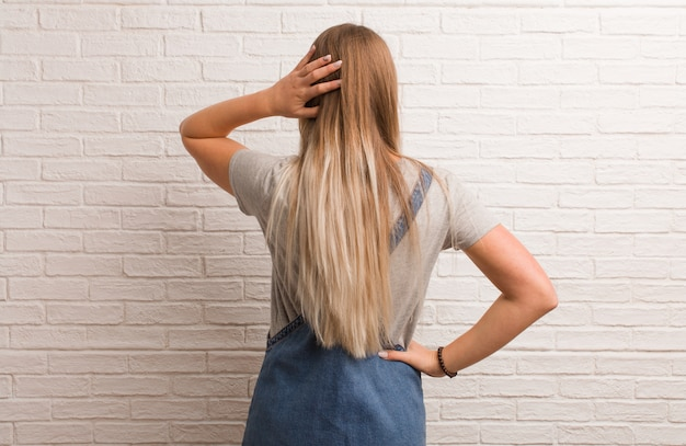 Young russian hipster woman from behind thinking about something