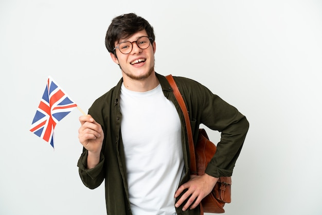 Young russian man holding an united kingdom flag