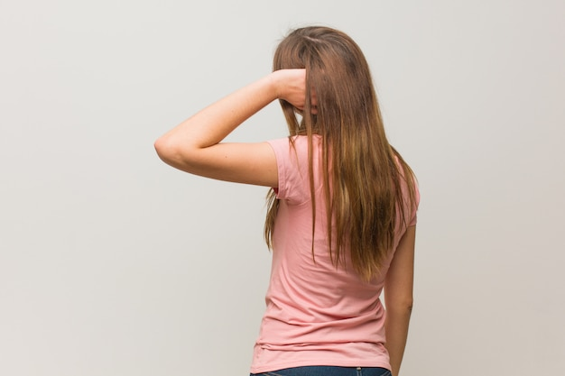 Young russian natural girl from behind thinking about something