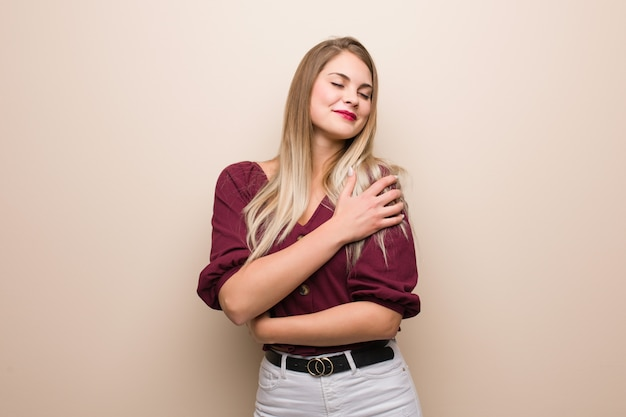 Young russian woman giving a hug
