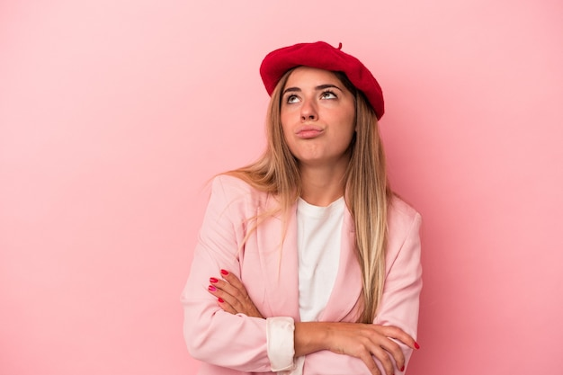 Young russian woman isolated on pink background showing number two with fingers.