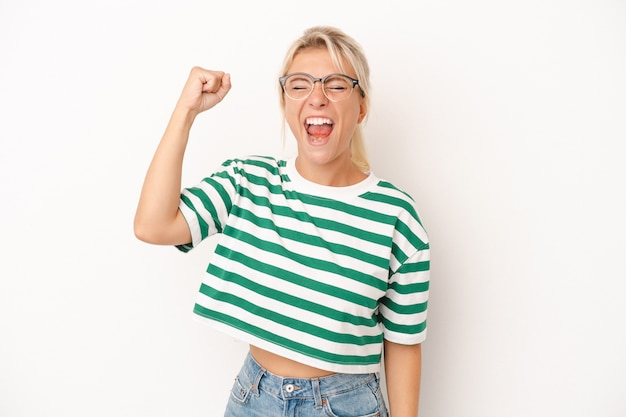 Young russian woman isolated on white background celebrating a victory, passion and enthusiasm, happy expression.