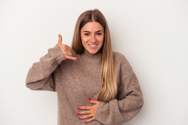 Young russian woman isolated on white background looks aside smiling, cheerful and pleasant.