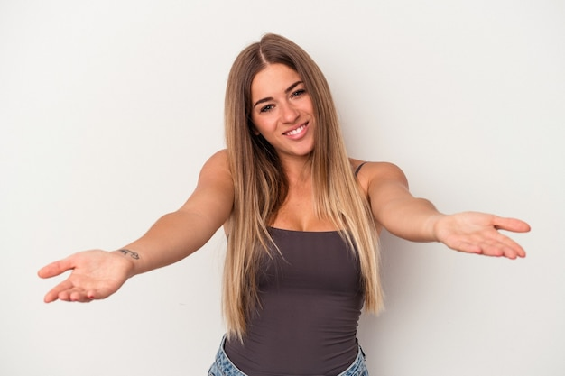 Young russian woman isolated on white background showing a welcome expression.