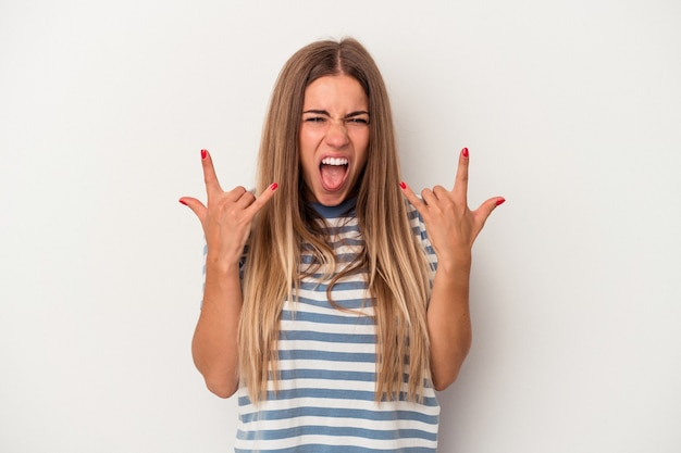 Young russian woman isolated on white background stretching hand at camera in greeting gesture.