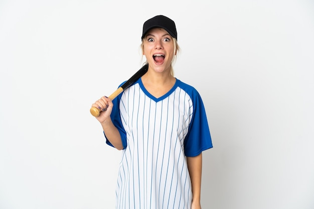 Young russian woman playing baseball isolated on white background with surprise facial expression