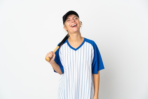 Young russian woman playing baseball isolated on white laughing