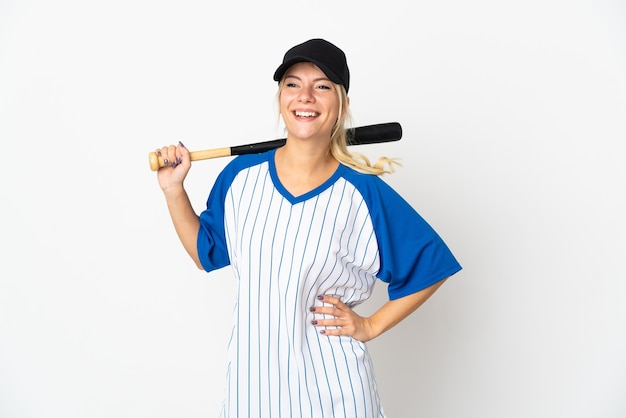 Young russian woman playing baseball isolated on white posing with arms at hip and smiling