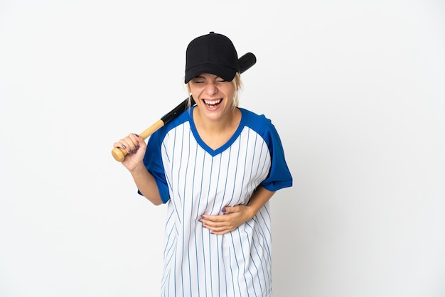 Young russian woman playing baseball isolated on white smiling a lot