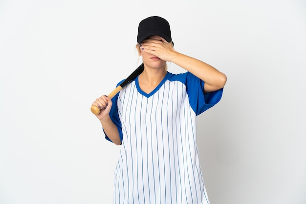 Young russian woman playing baseball isolated on white wall covering eyes by hands. do not want to see something