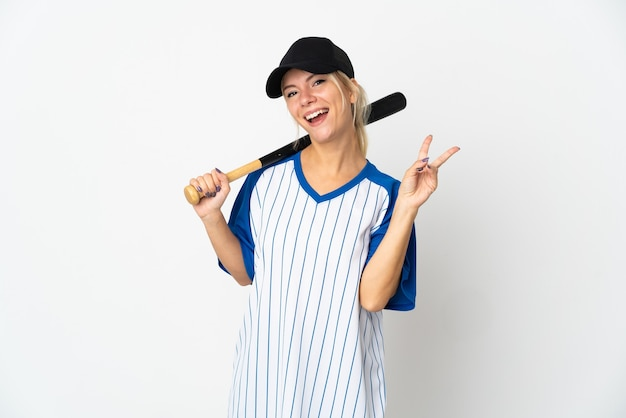 Young russian woman playing baseball isolated on white wall smiling and showing victory sign