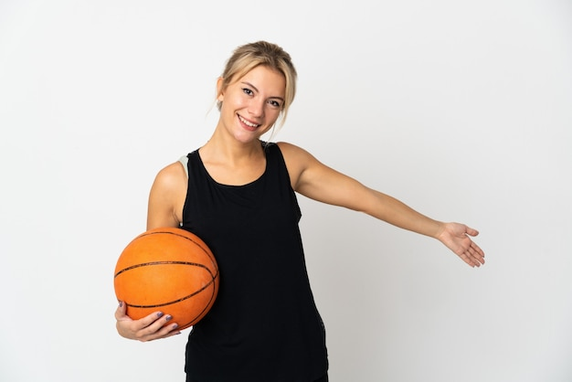 Young russian woman playing basketball isolated on white background extending hands to the side for inviting to come