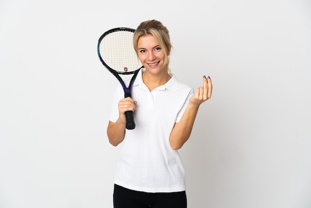 Young russian woman tennis player isolated on white making money gesture