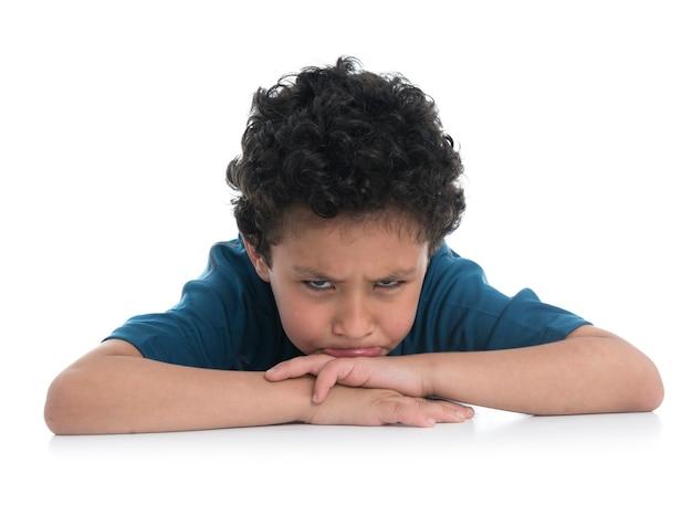 Young sad boy isolated