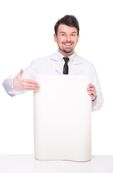 Young salesman is holding quality mattress.