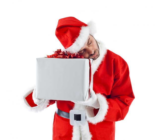 Young santa claus with gift box