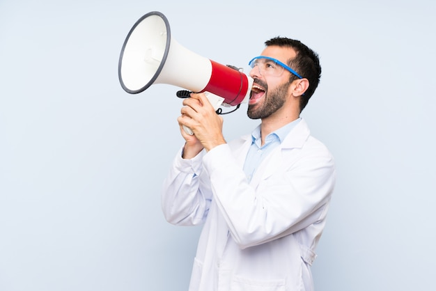Young scientific holding laboratory flask shouting through a megaphone