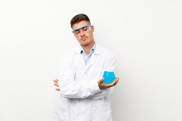 Young scientific holding laboratory flask  thinking an idea
