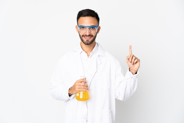 Young scientific man isolated pointing up a great idea