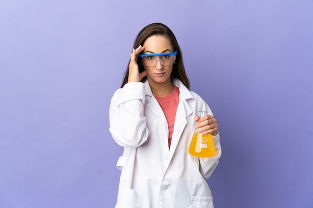 Young scientific woman over isolated wall thinking an idea
