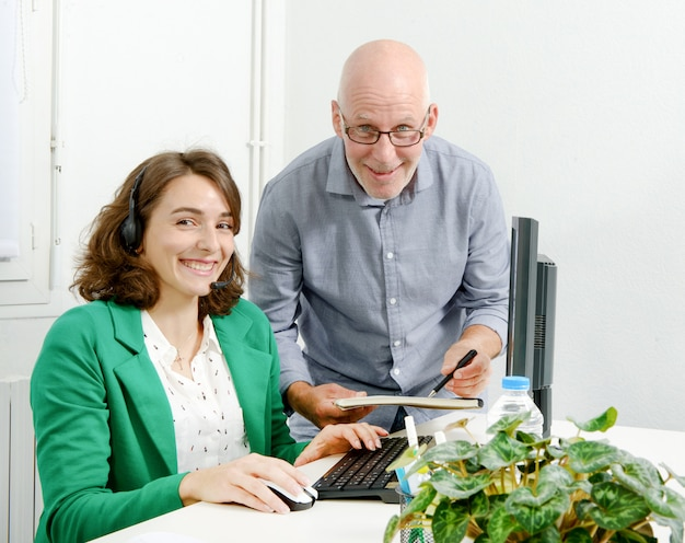Young secretary and his boss in the office