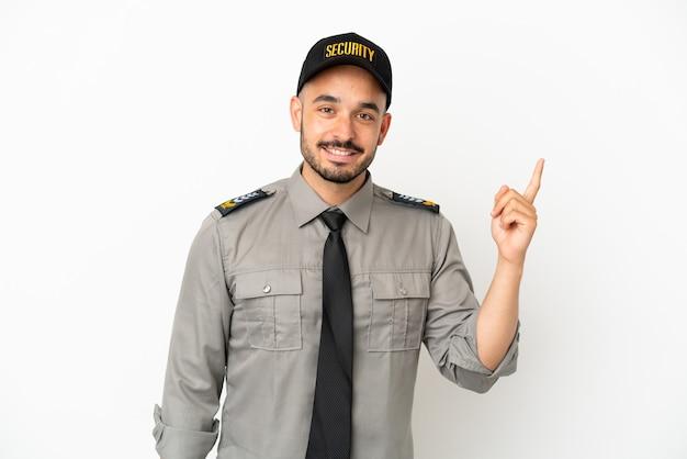Молодой человек безопасности кавказской изолирован на белом фоне, показывая и поднимая палец в знак лучших