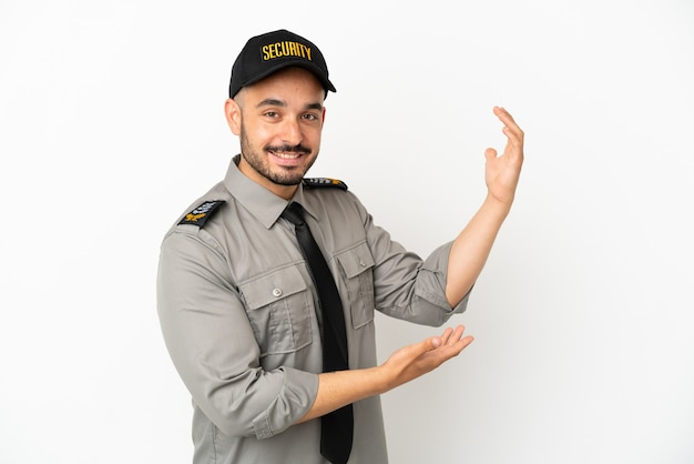 Young security  caucasian man isolated on white background extending hands to the side for inviting to come