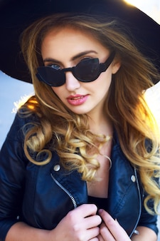 Young sensual pretty stylish blonde girl, with amazing long curled hairs