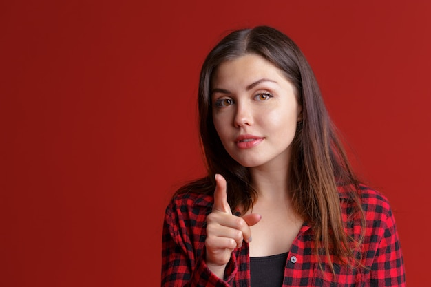 Young serious woman shaking wagging her finger