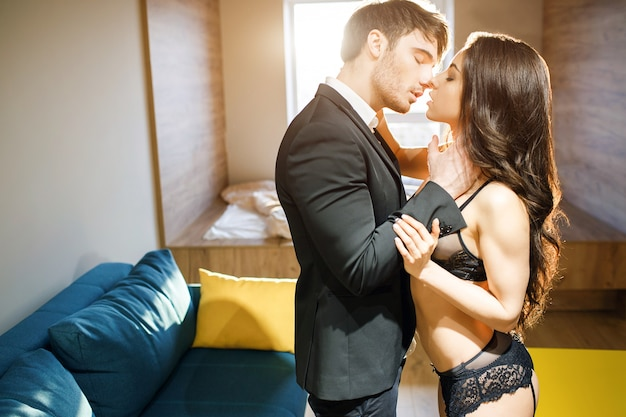 Young sexy couple in living room