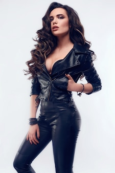 Young sexy girl with long hair in leather jacket