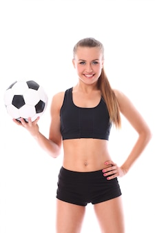 Young and sexy girl with soccer ball