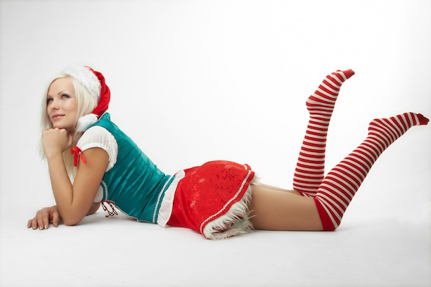 Young sexy santa girl isolated on white